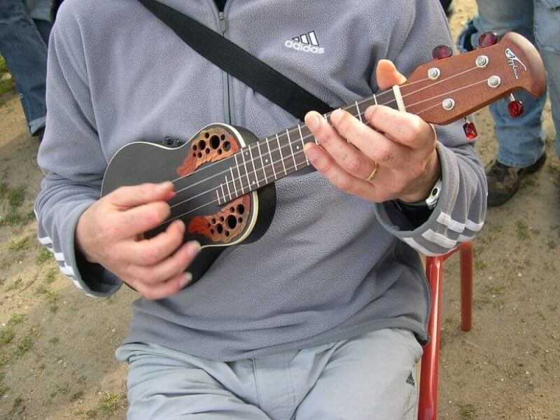 man playing ukelele