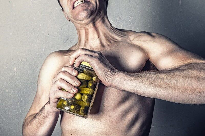 man opening a bottle