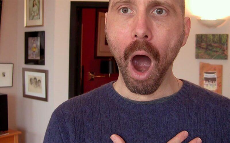 man doing voice exercises