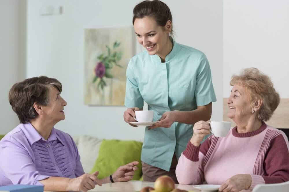 women being served tea