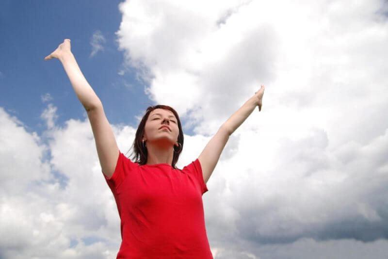 girl with arms wide open and sky background (Multiple values)