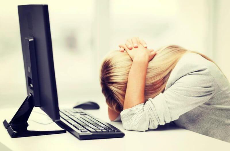 lady sleeping on working desk