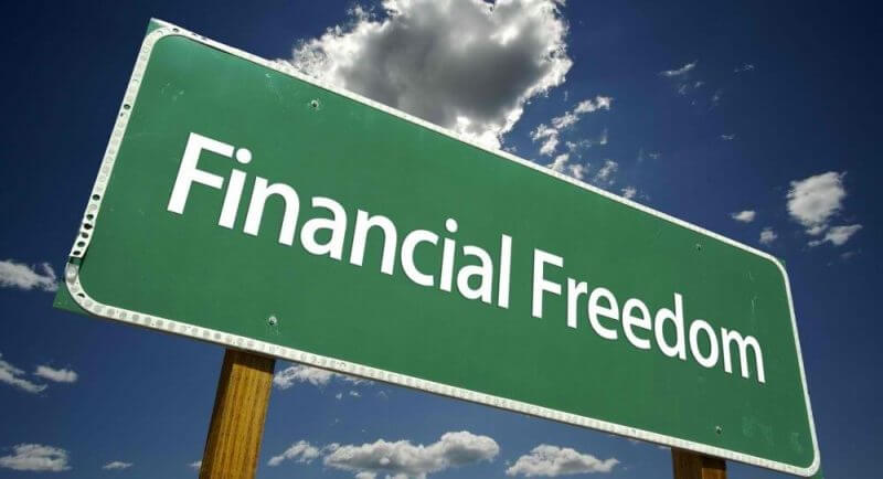 financial freedom written on a green board