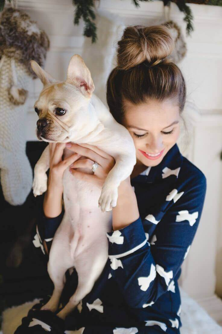 a lady caring a dog