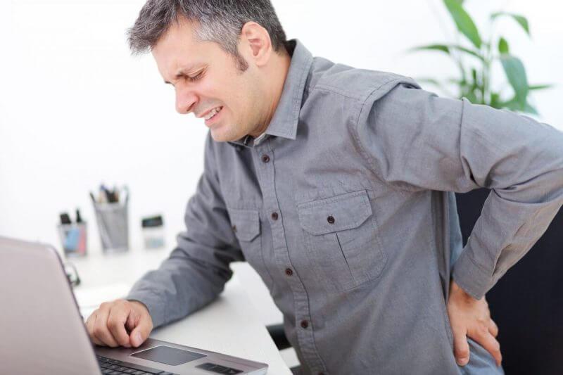 man having back pains