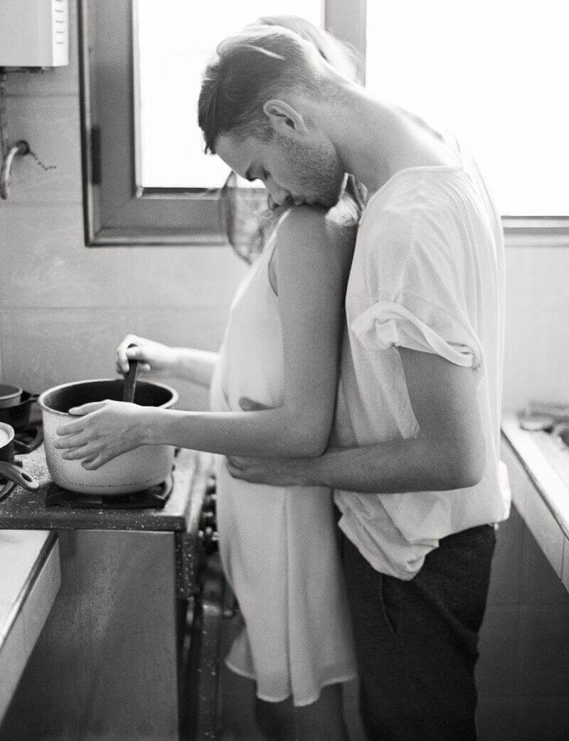 couple holding each other in kitchen