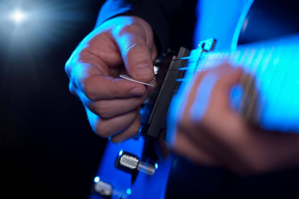 A PERSONN PLAYING A SONG FROM A GUITAR