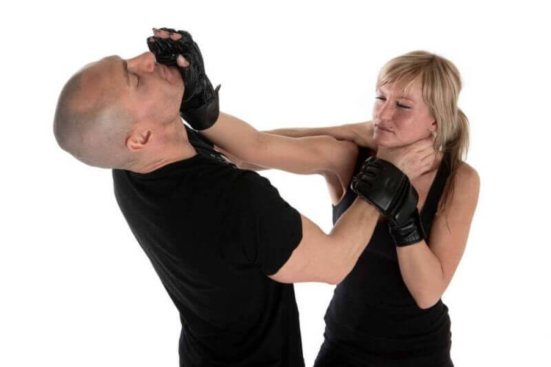 a man and a lady training on self-defense techniques