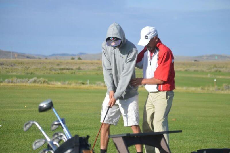 men training for golf