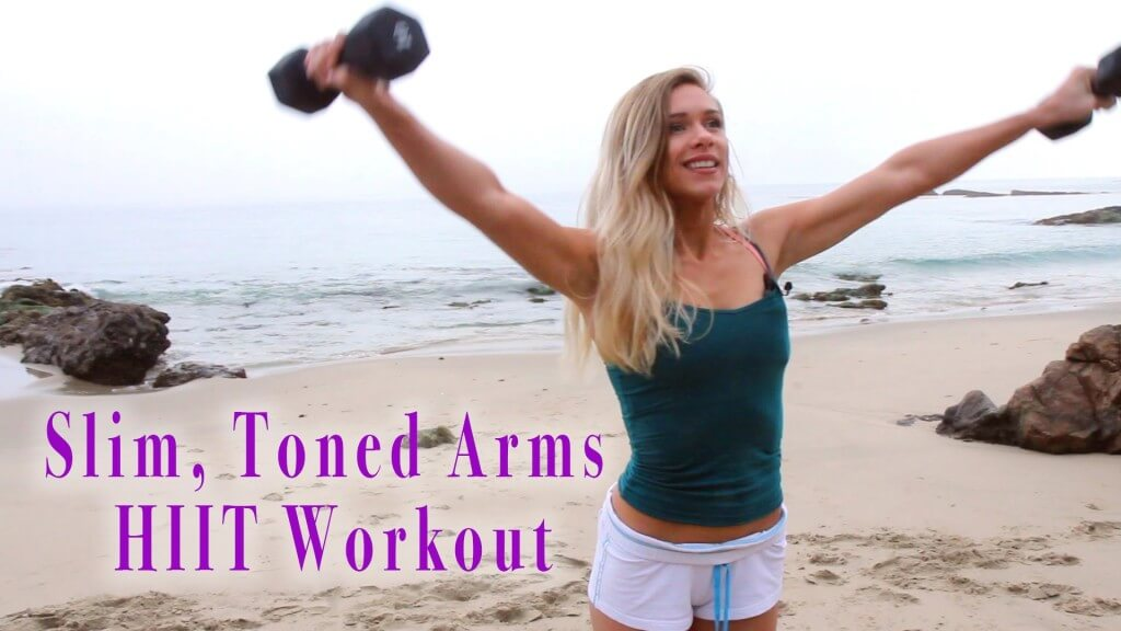 woman in the beach doing arms exercises
