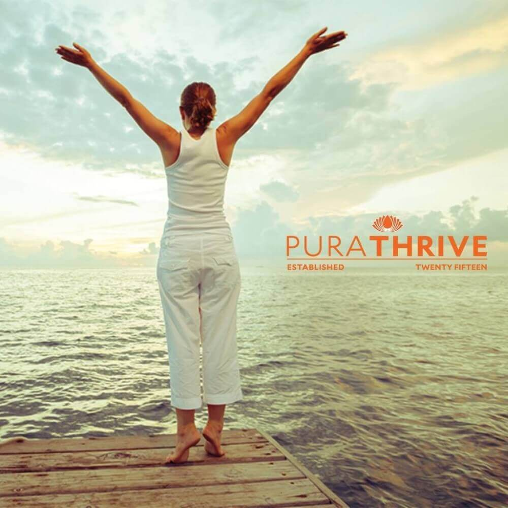 woman with her hands up, purathrive