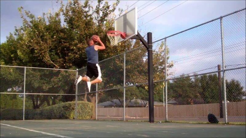 man jumping to make a basket