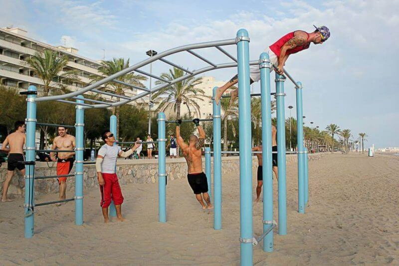 men in the beach exercising