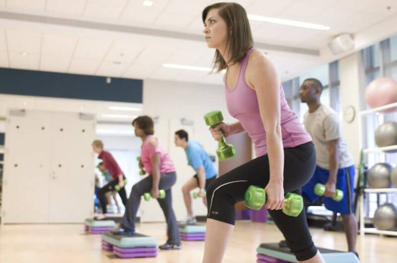 people in the gym exercising