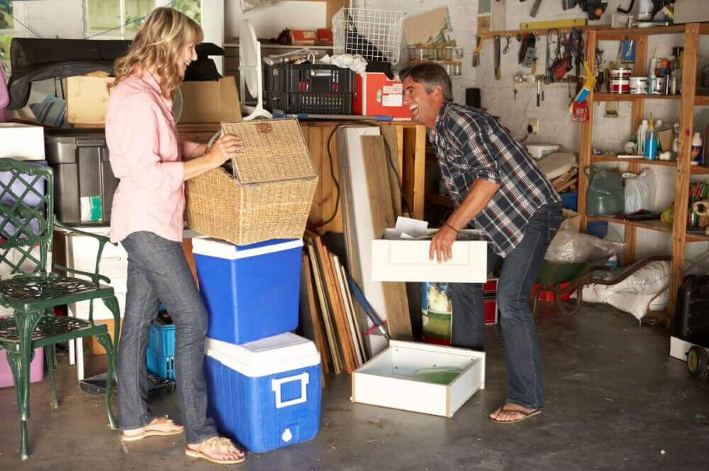 a man and woman trying to arrange some items