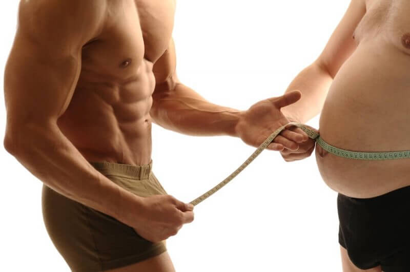 Trainer measures overweight man