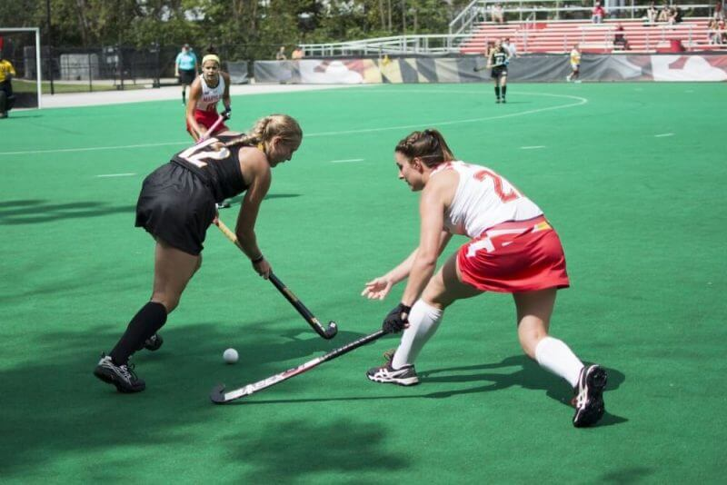 ladies playing hockey