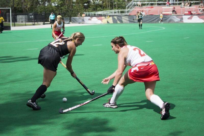 ladies playing hockey