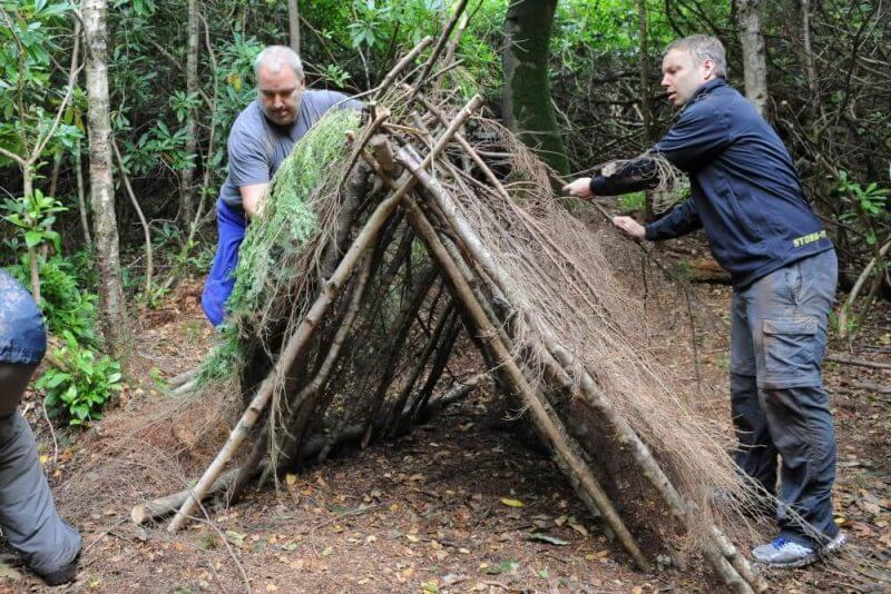 men preparing a camp