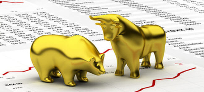 statures of golden animals on a piece of paper