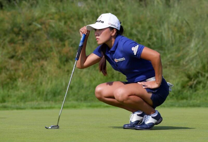 a lady playing golf
