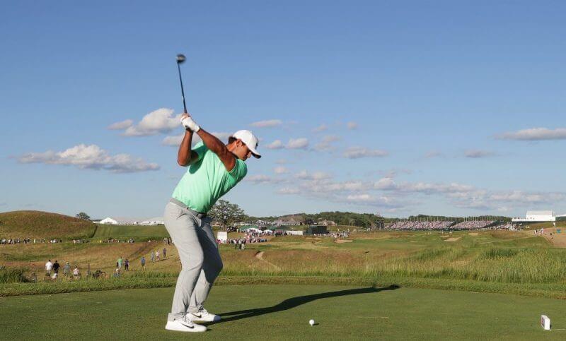 man practicing golf