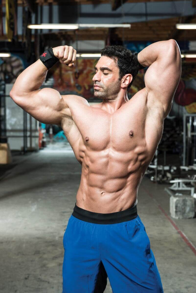 musculine man showing his biceps