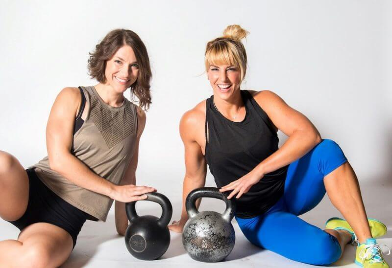 two ladies with kettlebells