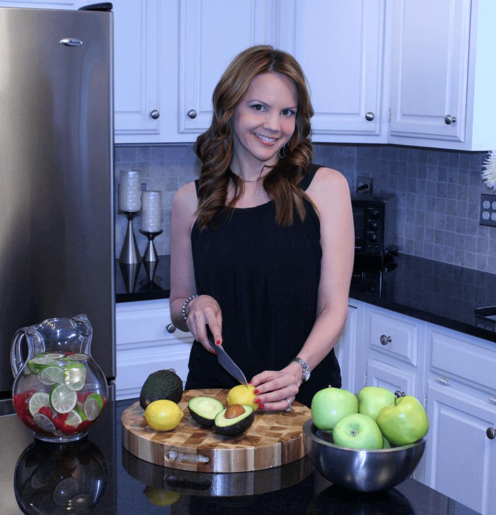 SMILING WOMAN SLICING FRUITS