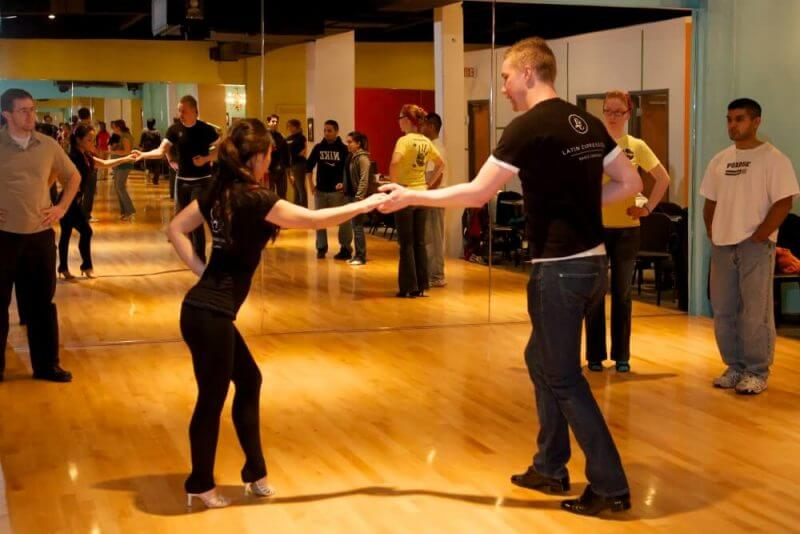 man and woman dancing salsa
