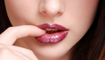 cute lady holding her lips