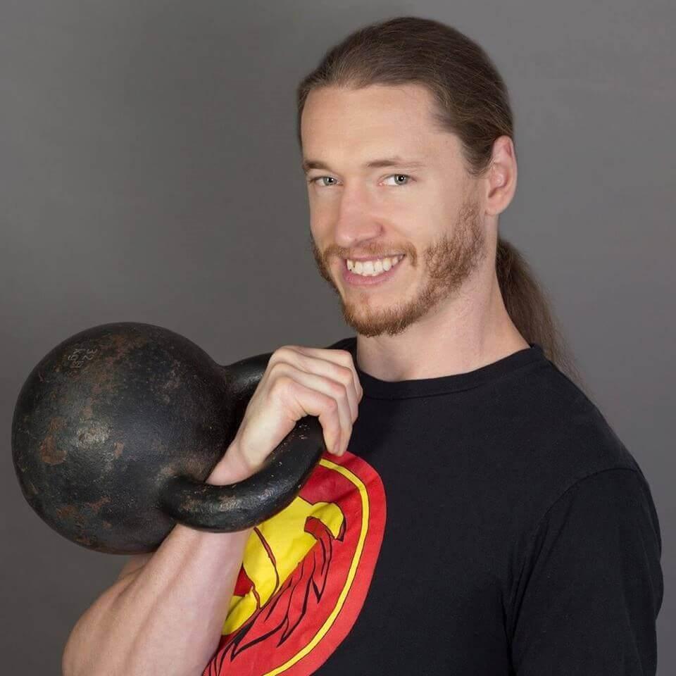 man holding kettleball