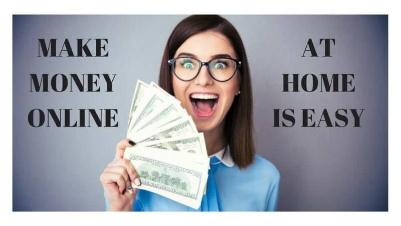 a woman holding dollar bills and celebrating