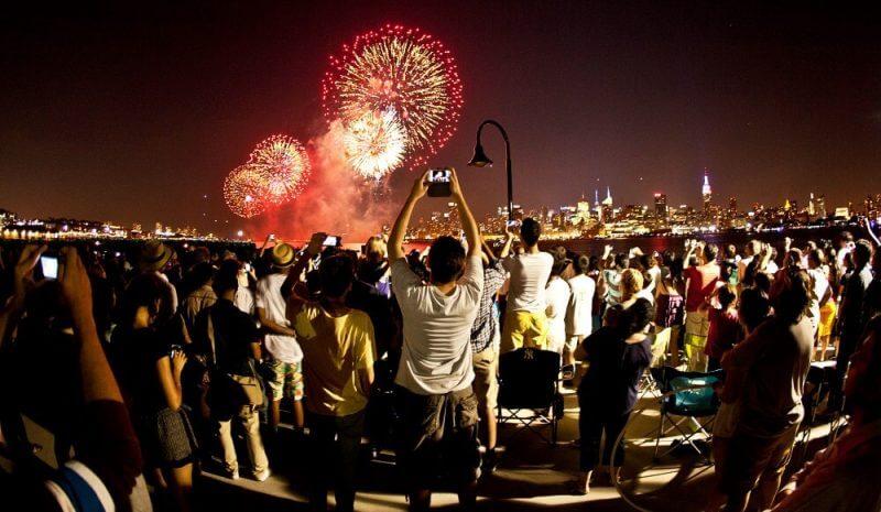 people celebrating fireworks