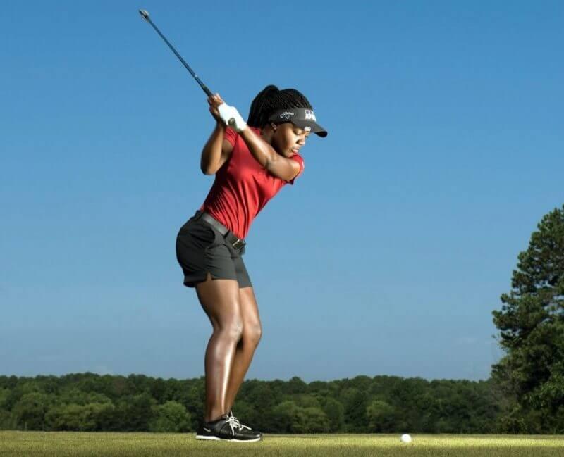 lady playing golf