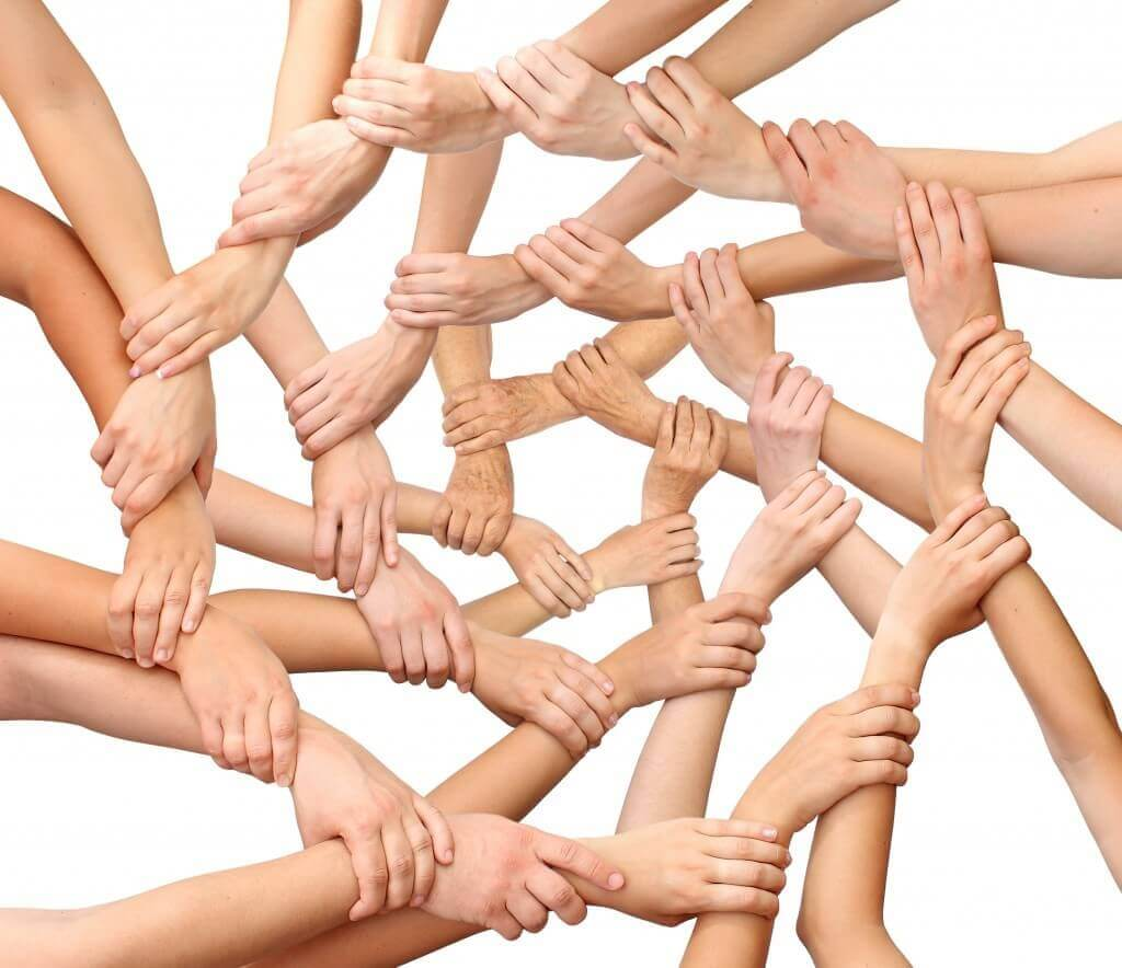 multiple hands joined together