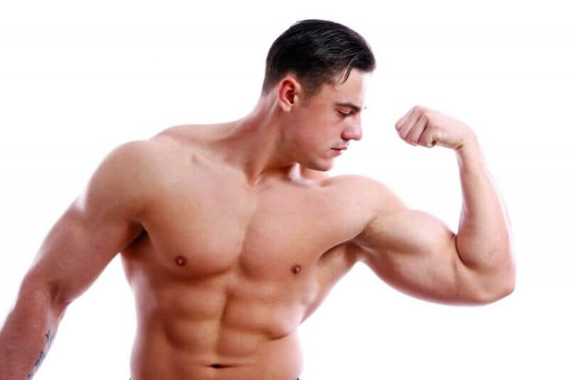 musculine man showing his biscep