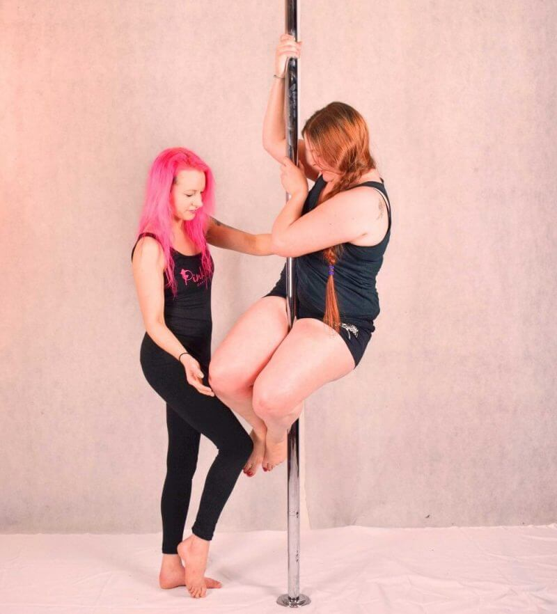 girls trying pole dance
