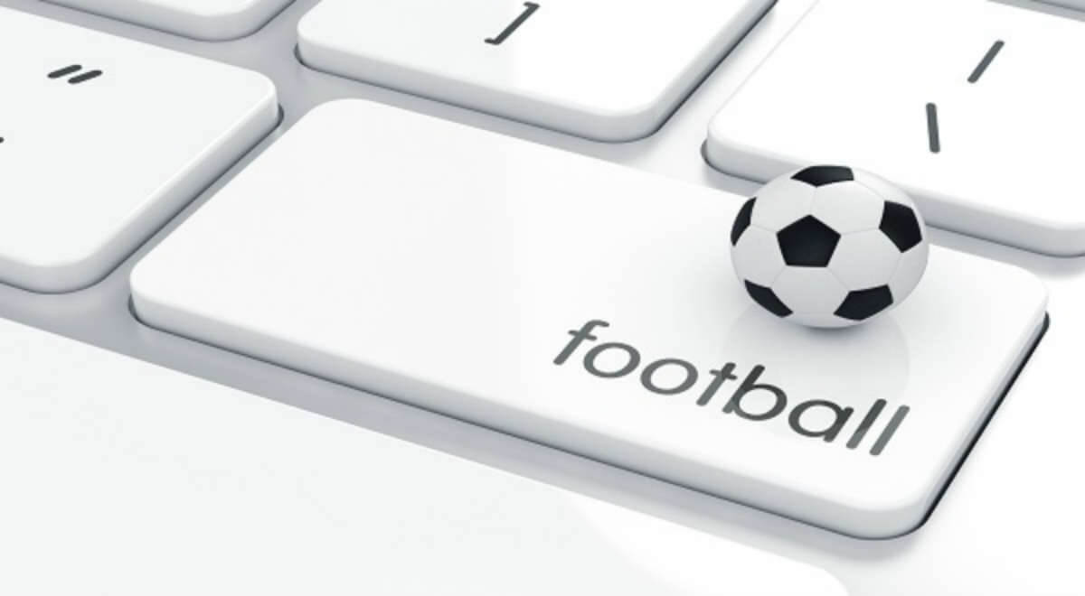 football written on a keyboard and a ball on it