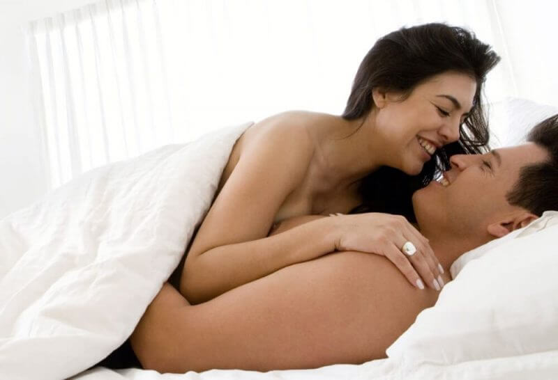 man and woman making love in bed