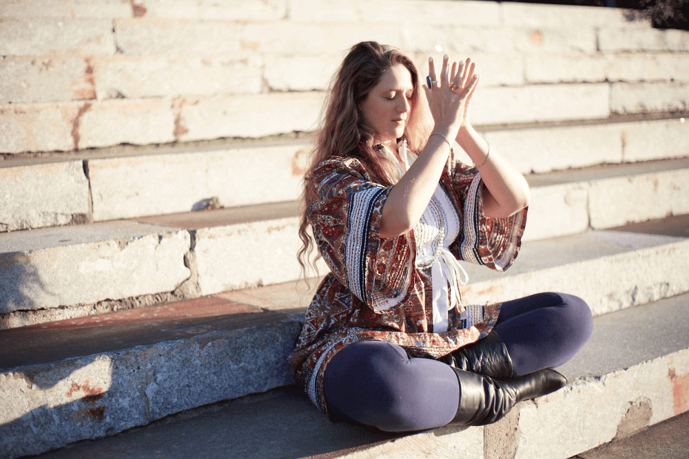 woman seated doing some meditation