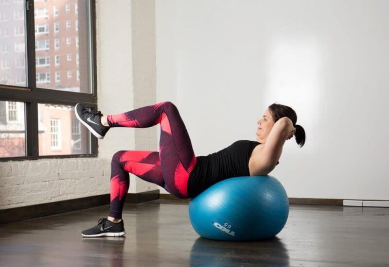 a woman using a gym ball