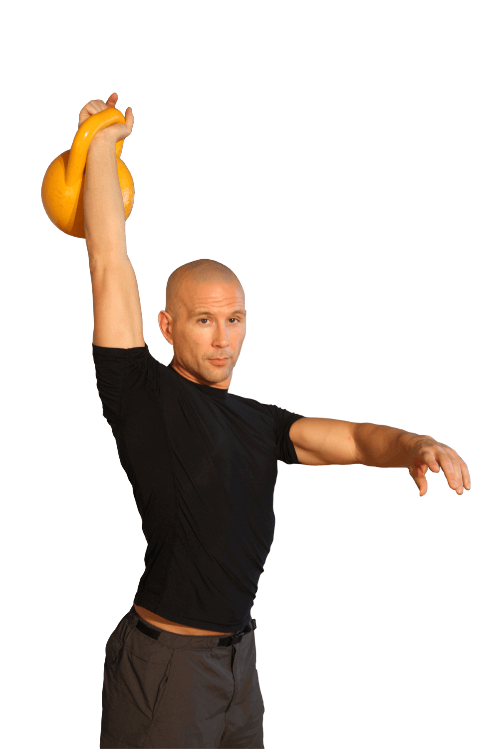 tacfit commando lifting a kettle ball