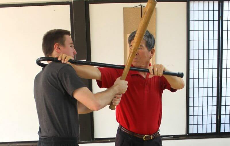 a man using a self-defense cain to protect himself