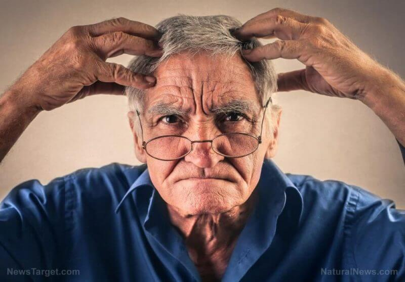 old man with hands on the head