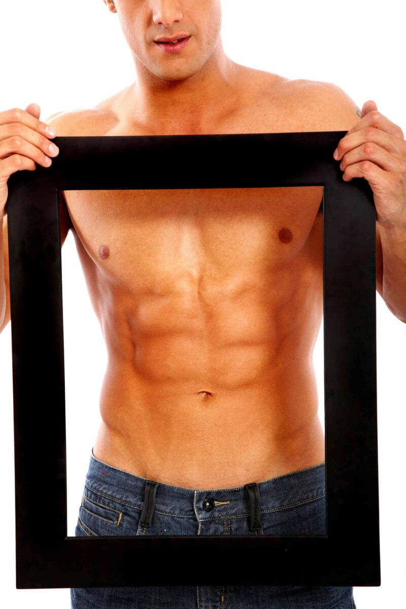 strong muscular man framing his abdominal muscles and chest with a black frame