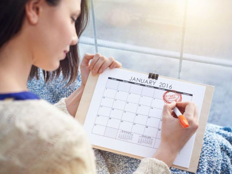 woman checking dates on a calender