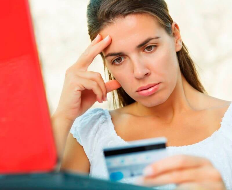 lady looking stressed about her credit card