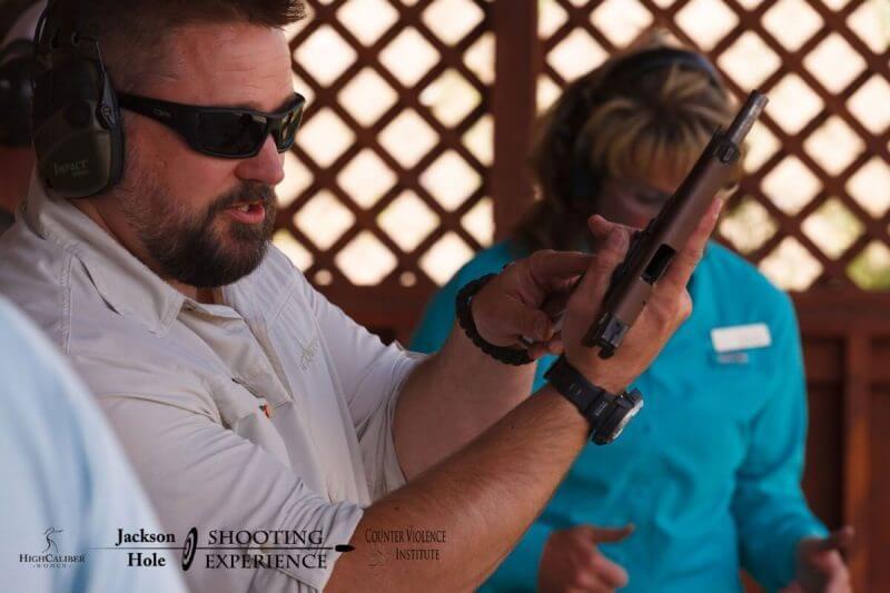 man holding a handgun