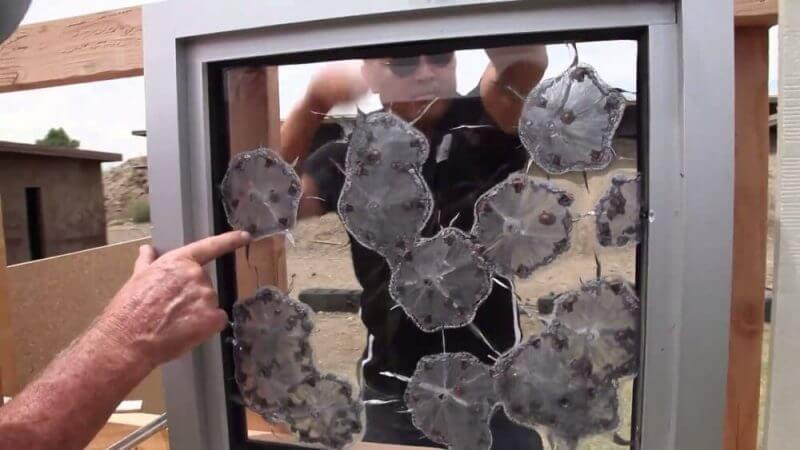 a man working on a bulletproof glass